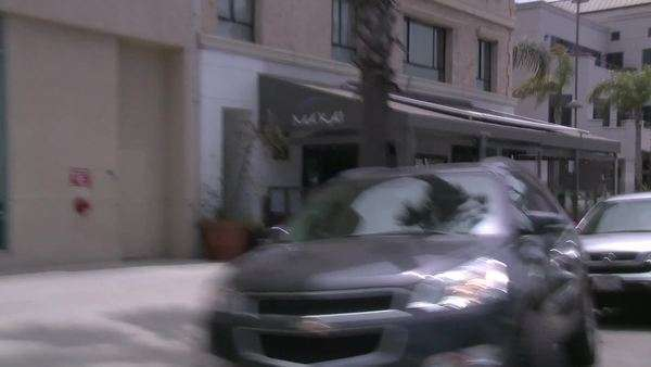 A vehicle drives in a downtown neighborhood of Santa Monica, California. Royalty-free stock video