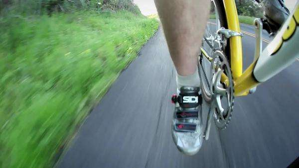 A bicyclist rides down a road. Royalty-free stock video