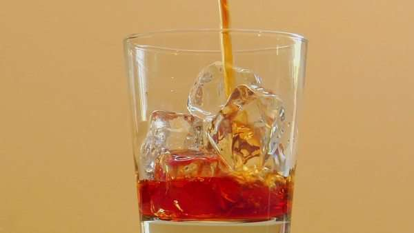 Liquor is poured into a glass with ice. Royalty-free stock video