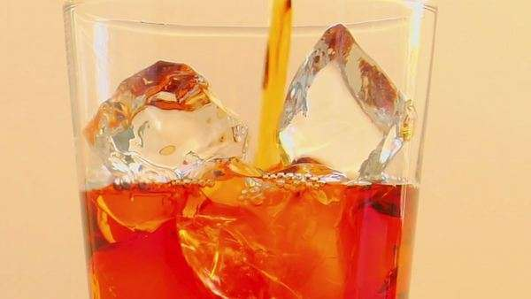 Tilt up to as liquor is poured into a glass with ice. Royalty-free stock video