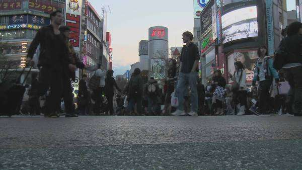 Pedestrian crossing during rush hour near Shibuya Station Tokyo Japan. Royalty-free stock video