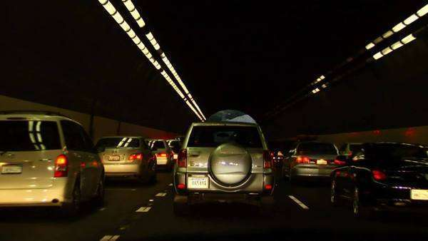 Traffic drives on a highway and through tunnels. Royalty-free stock video