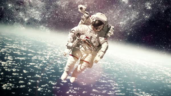 Astronaut in outer space against the backdrop of the planet earth Royalty-free stock video