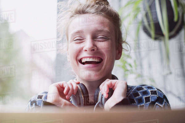 Portrait laughing young woman with headphones Royalty-free stock photo