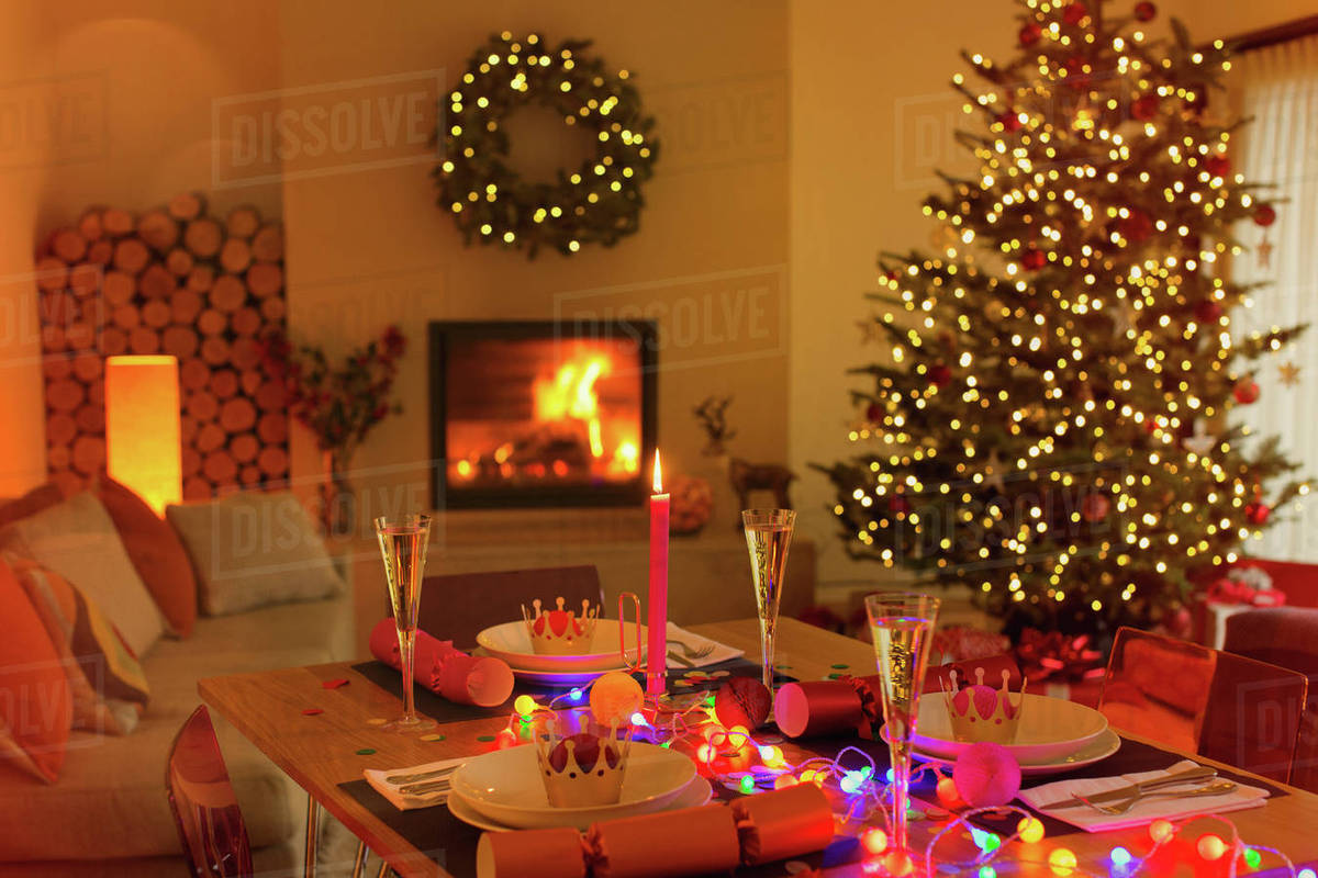 Living Christmas Tree.Ambient Christmas Dinner Table In Living Room With Fireplace And Christmas Tree Stock Photo