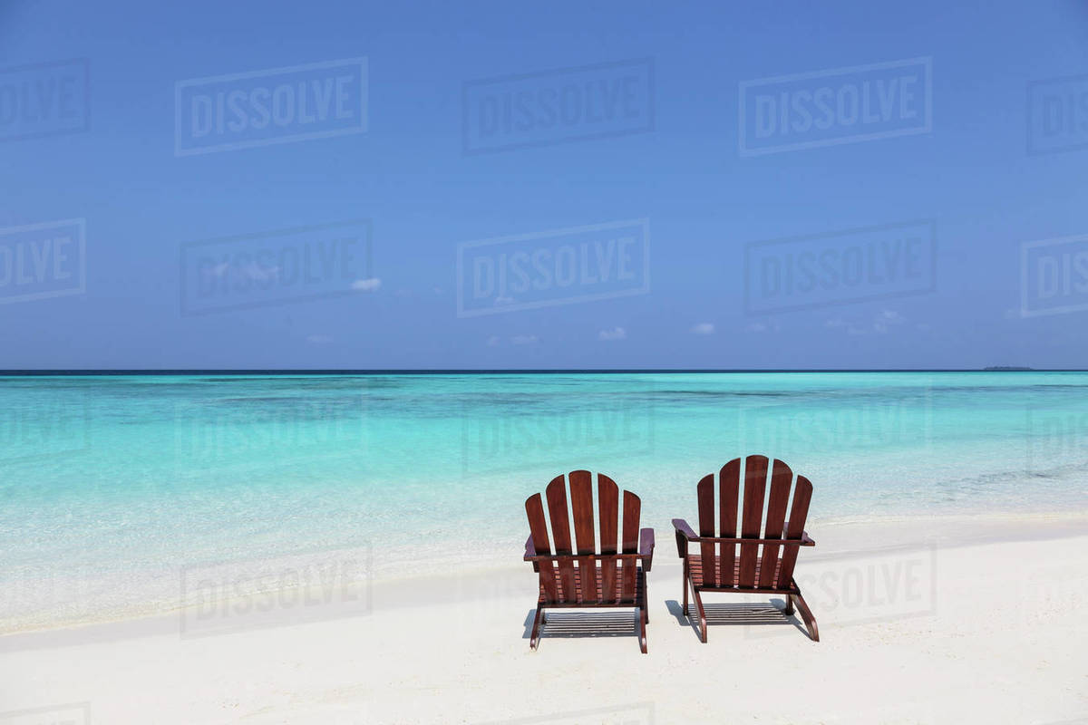 Two Adirondack Chairs On Sunny Tranquil Beach Overlooking Blue Ocean D1007 21 205