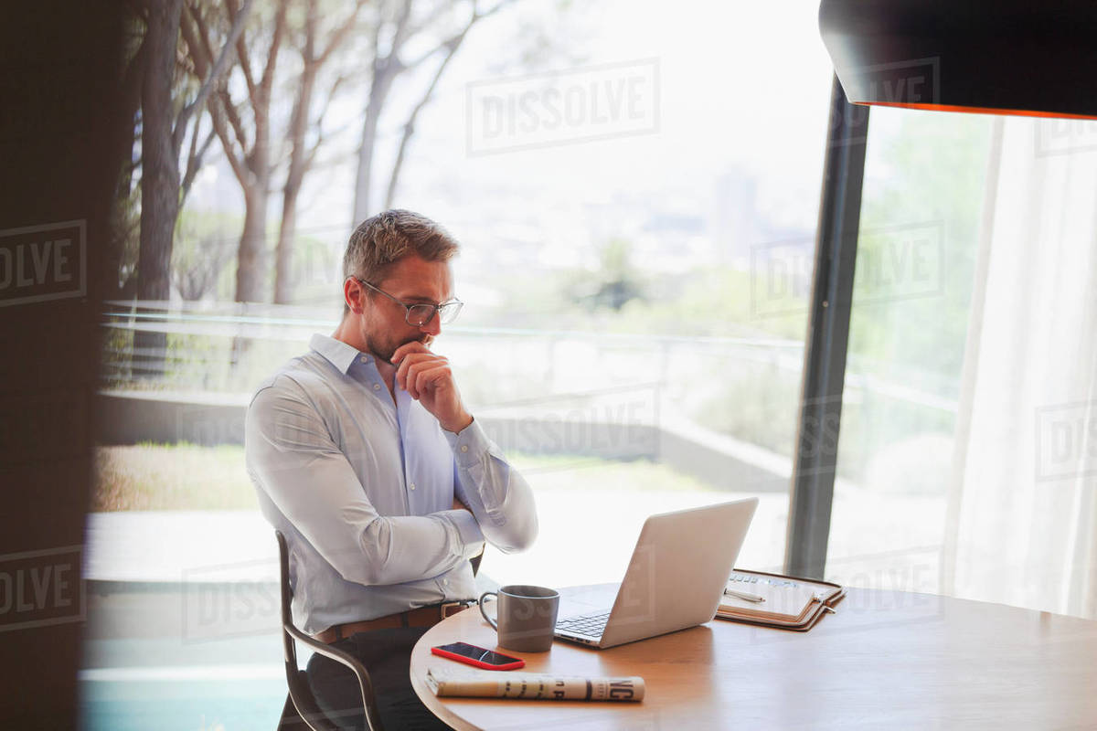 Businessman using laptop, working from home Royalty-free stock photo