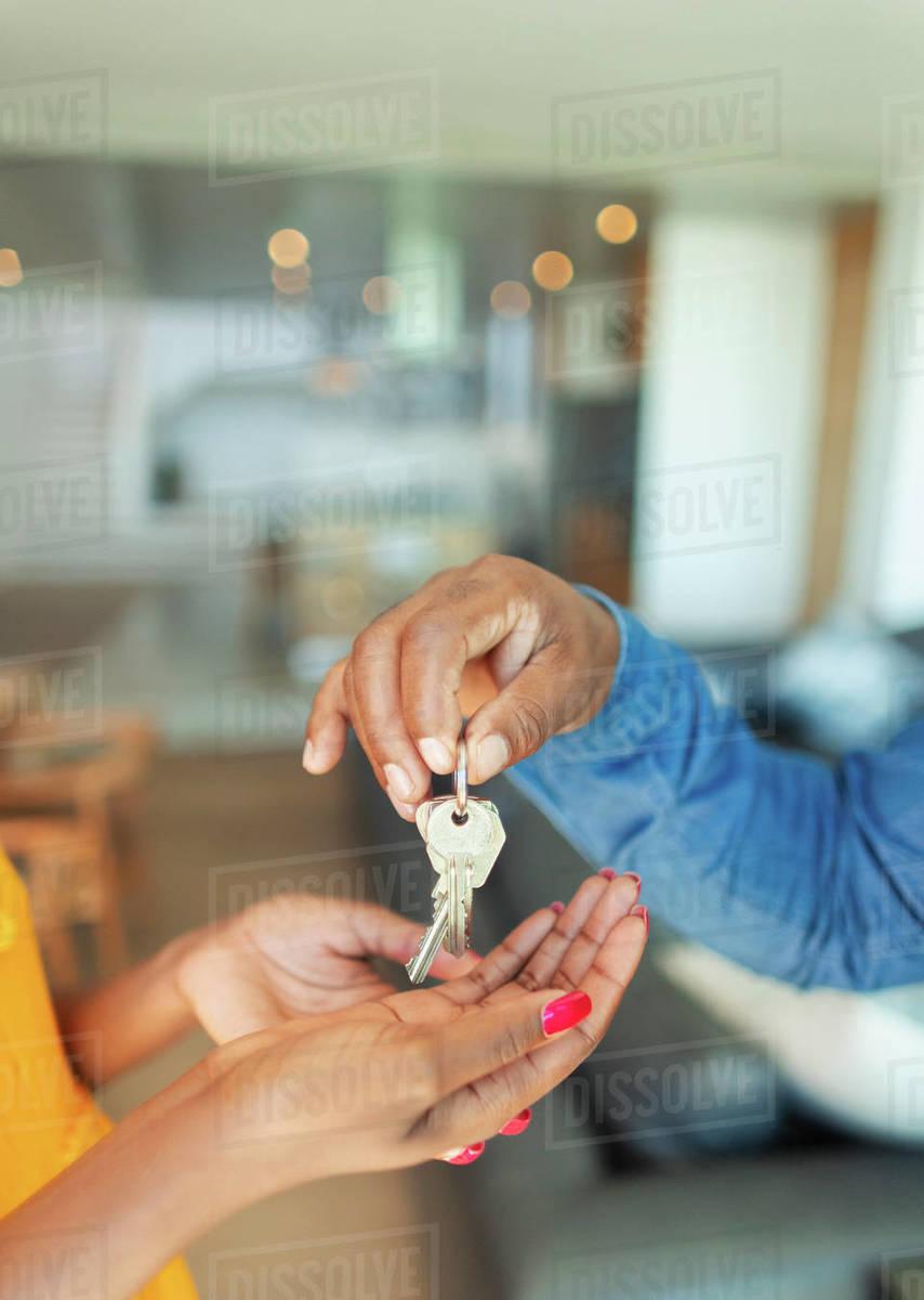 Close up man handing house keys to woman Royalty-free stock photo