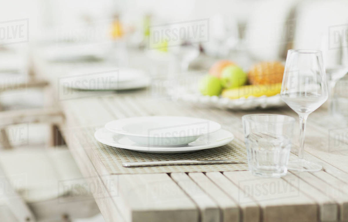 Placesettings On Bleached Wood Dining Table Stock Photo Dissolve - Bleached wood dining table