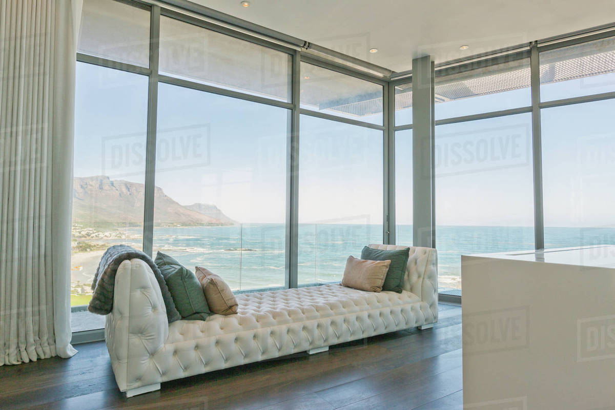 Tufted Chaise Lounge At Luxury Home Showcase Interior Window With Ocean View