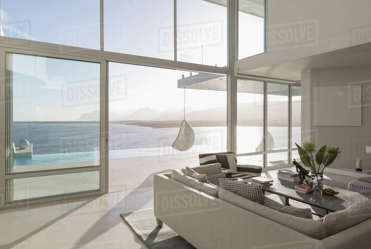 Sunny, tranquil modern luxury home showcase interior living room ...