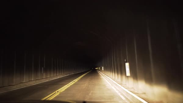 Point of view shot of a car driving through a tunnel Royalty-free stock video