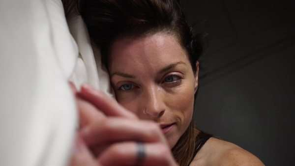 Close-up shot of a woman lying on a bed and caressing lover's hand Royalty-free stock video