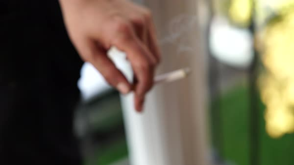Close-up of a person holding a cigarette Royalty-free stock video