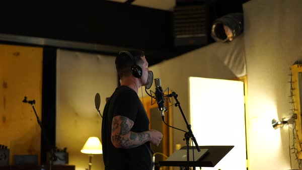 Medium shot of a man singing in a studio Royalty-free stock video