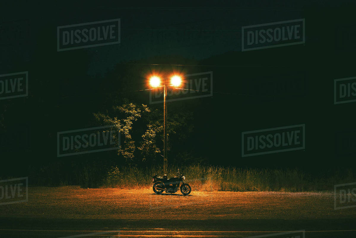 Motorcycle under streetlight Royalty-free stock photo