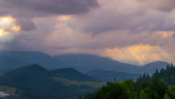 Timelapse. Mountain Landscape. Sun Rays Pass through the Clouds Over the Mountains at Sunset. Royalty-free stock video