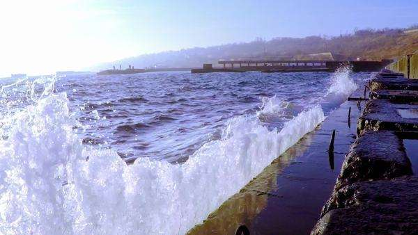 Waves breaking on the breakwater, a wall of water rises and falls down, slow motion. Royalty-free stock video