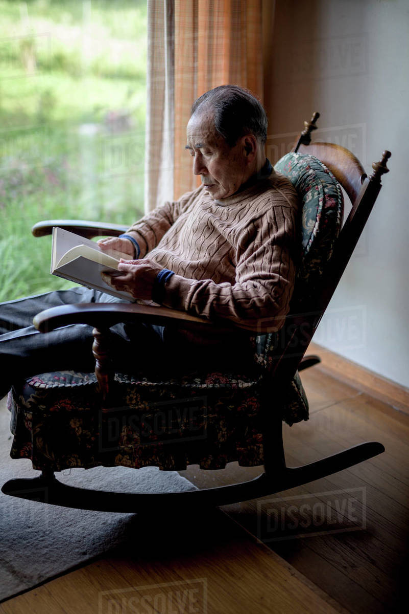 Phenomenal Elderly Man Sitting In Rocking Chair By A Window Reading D1024 100 141 Pdpeps Interior Chair Design Pdpepsorg