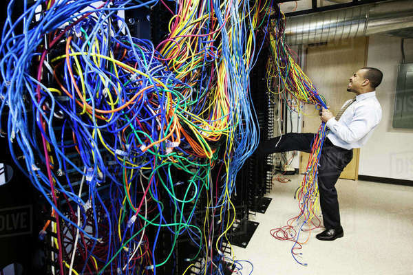 a mess of cat 5 cables in an office server room stock photo dissolve. Black Bedroom Furniture Sets. Home Design Ideas