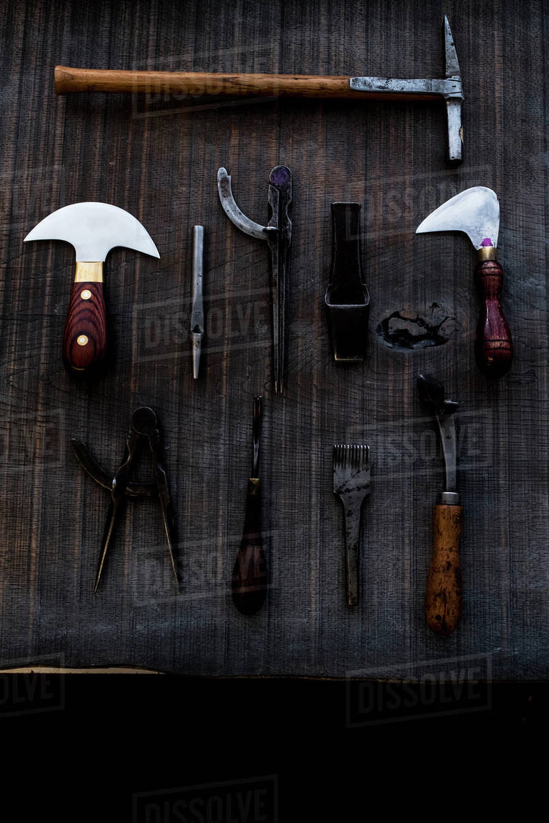 High angle close up of selection of saddle making hand tools. Royalty-free stock photo