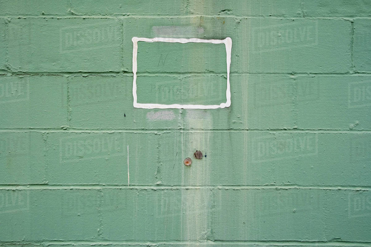 """""""No Parking"""" written on building wall, enclosed by painted white square Royalty-free stock photo"""