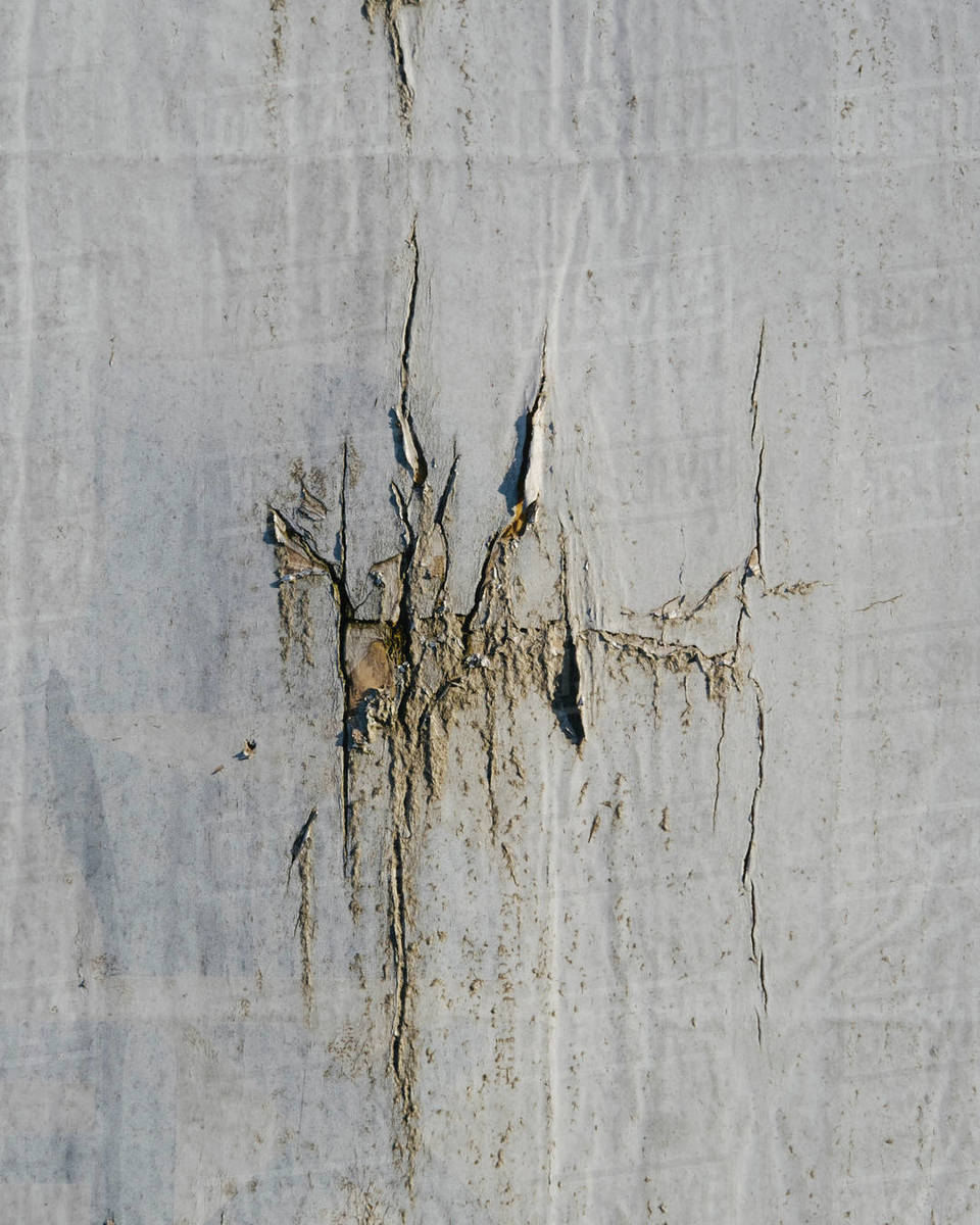 Close up of cracked insulation paneling on urban wall Royalty-free stock photo