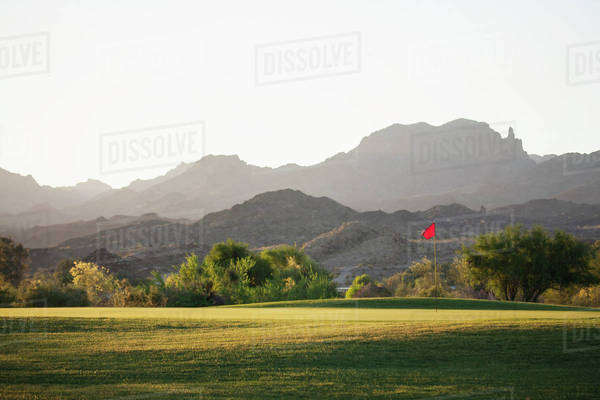 A golf course in Arizona, and a view to mountains.  Royalty-free stock photo
