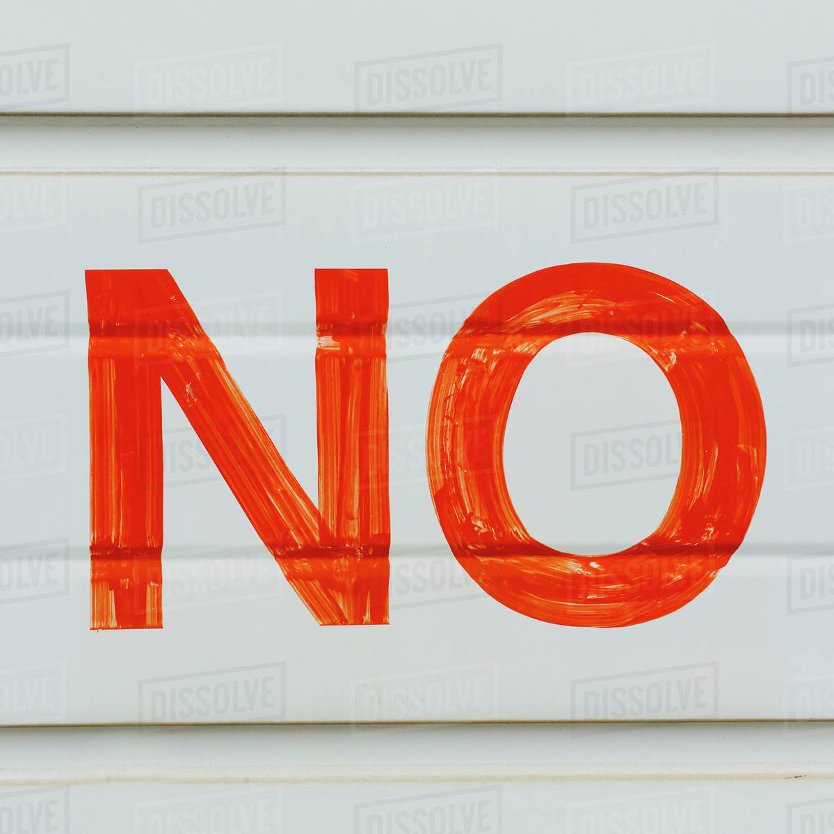 A Large No Sign In Red Paint On A Garage Door Indicating No Parking