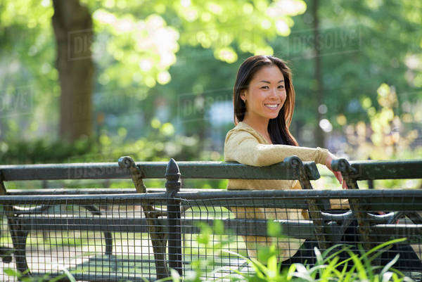 A Woman Sitting In A City Park On A Bench In The Sunshine.  Royalty-free stock photo