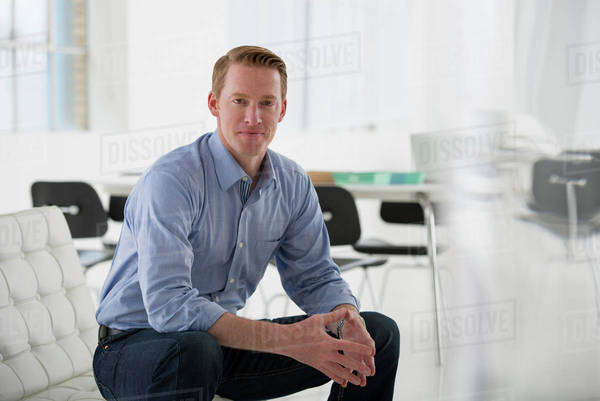 Business. A Man In A Blue Shirt Sitting Down.  Royalty-free stock photo