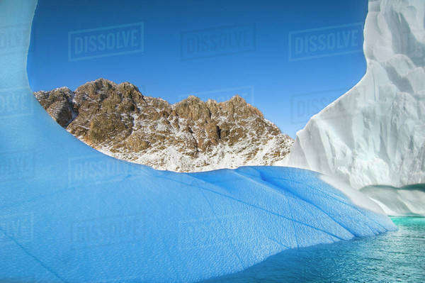 Iceberg and mountain, East Greenland Rights-managed stock photo