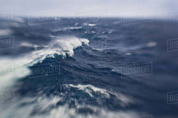 Stormy seas of Drake Passage, the water channel between Antarctica and the tip of South America, which is where the waters of the Atlantic and Pacific oceans meet.  Rights-managed stock photo