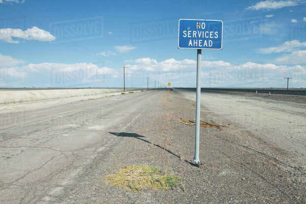 No Services Ahead warning sign on a remote desert road. Royalty-free stock photo