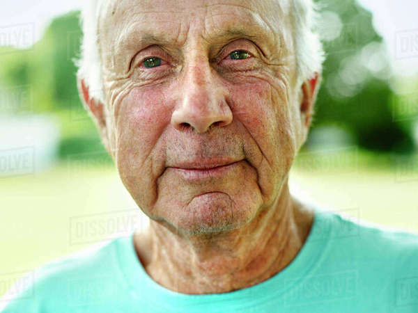 Portrait of a senior man with grey hair, smiling at camera. Royalty-free stock photo