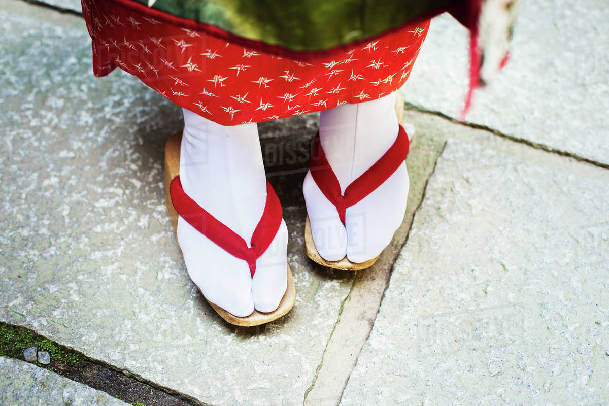 FeetIn Stockings White Photo Geisha SandalsWith Traditional Soled Red Straps Or A Wooden And Woman's TabiStock A5j3RLc4q