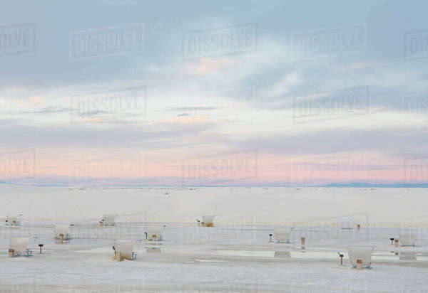 Picnic tables and shelters at White Sands National Park, dusk Royalty-free stock photo