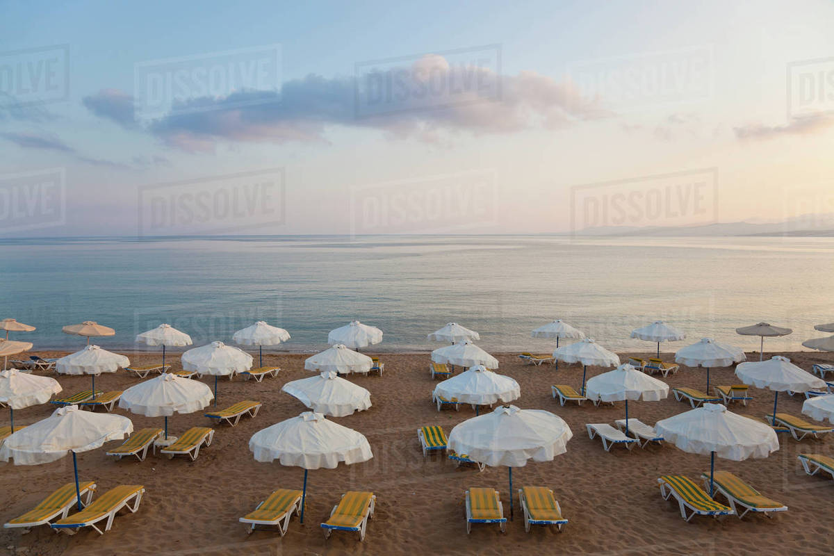 High Angle View Of Rows Sun Loungers And Umbrellas On A Sandy Beach In The Mediterranean