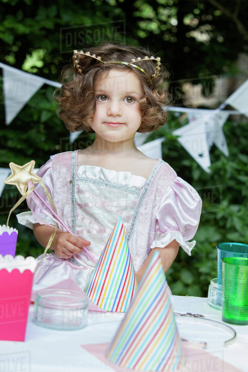 Young girl dressed as a fairy at a garden party. Royalty-free stock photo