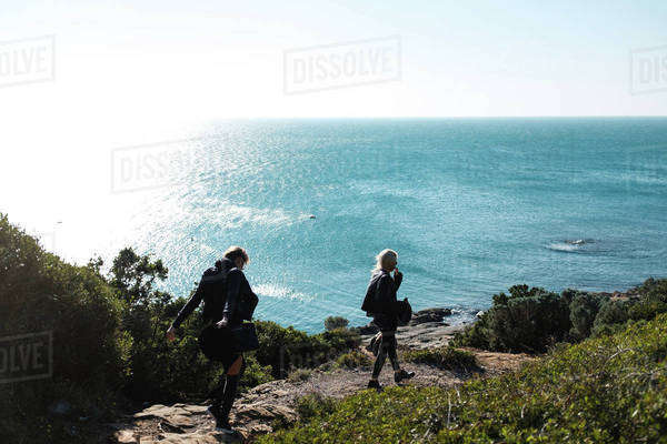 Young women walking on a coast Royalty-free stock photo