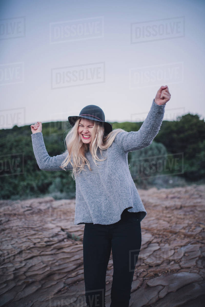 Portrait of a cheerful woman standing on a coast Royalty-free stock photo