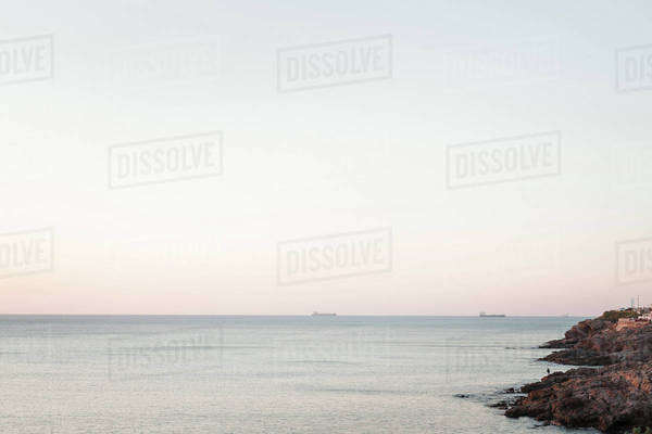 Cargo ships on the water at sunset Royalty-free stock photo