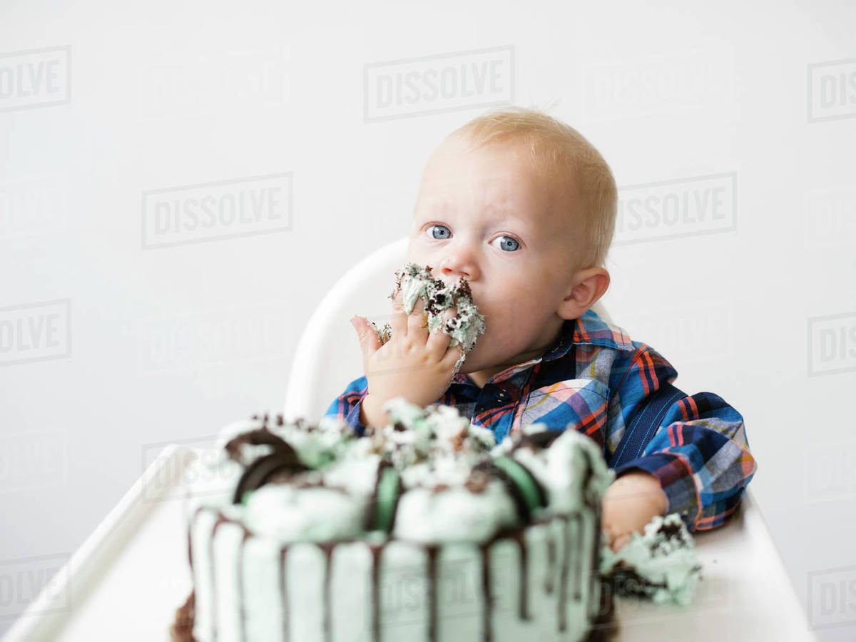 Enjoyable Baby Boy Eating Birthday Cake Stock Photo Dissolve Funny Birthday Cards Online Inifofree Goldxyz