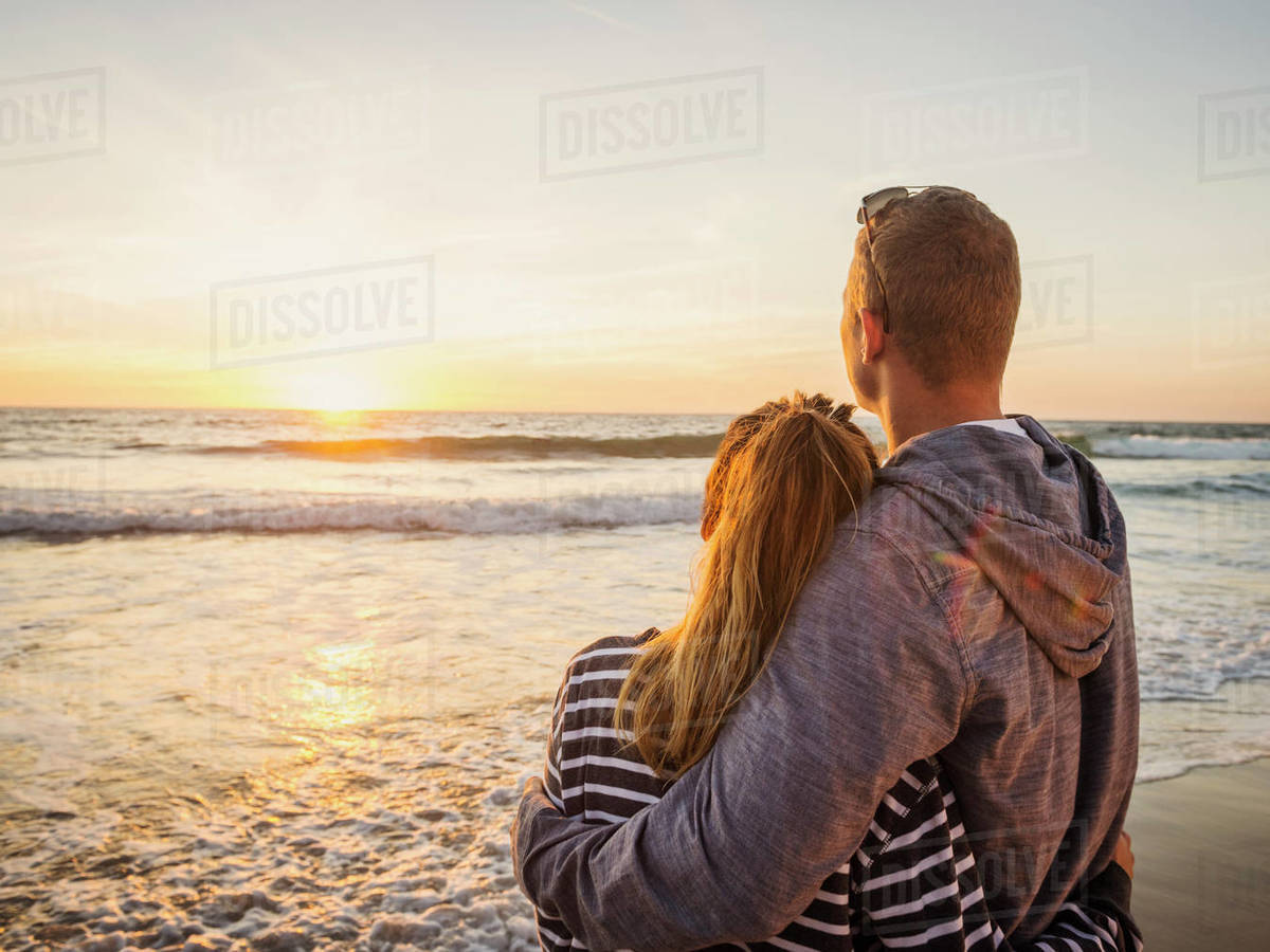 Couple looking at sunset Royalty-free stock photo