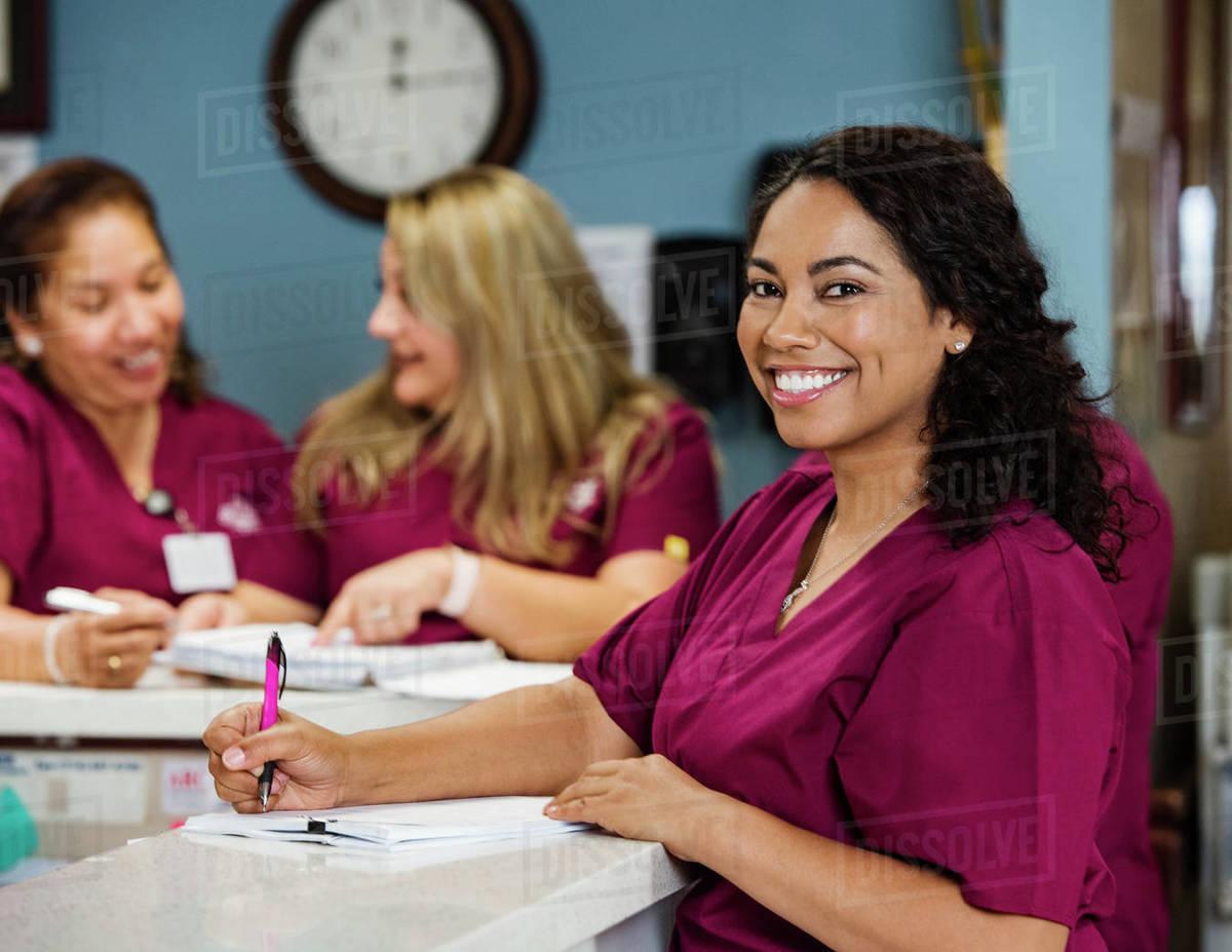 Nurses at reception desk Royalty-free stock photo