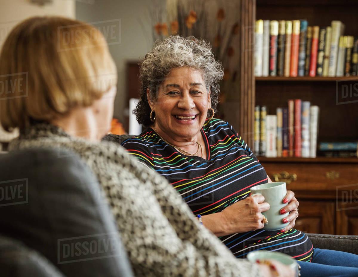 Senior women drinking tea and talking Royalty-free stock photo