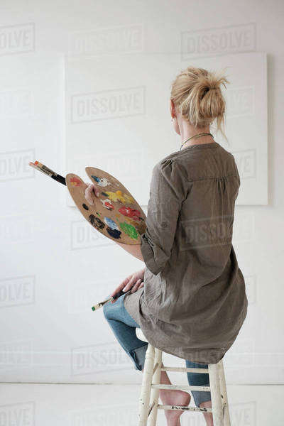 Female artist painting in studio Royalty-free stock photo