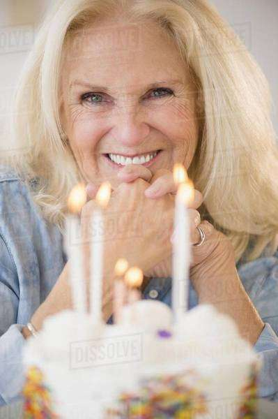 Portrait of senior woman with birthday cake Royalty-free stock photo