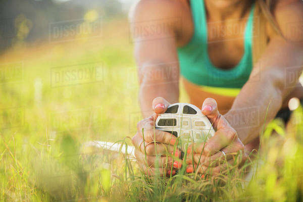 Woman exercising in field Royalty-free stock photo
