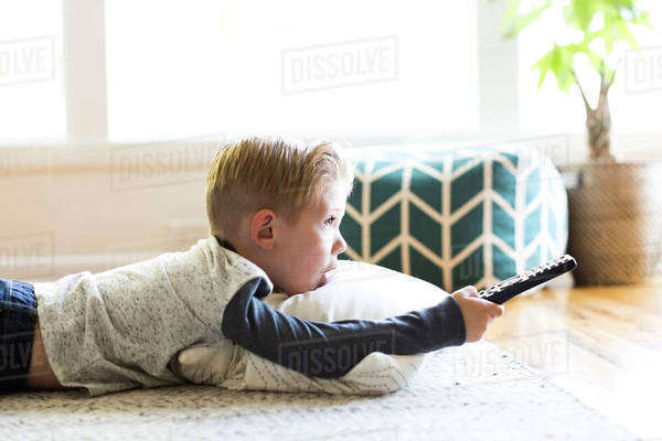 Boy (4-5) watching tv in living room Royalty-free stock photo
